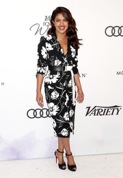 Priyanka Chopra polished off her look with black ankle-strap peep-toes by Christian Louboutin.