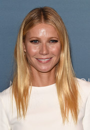 Gwyneth Paltrow attended the Power of Women luncheon wearing her signature straight, center-parted style.