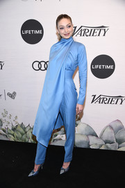 Gigi Hadid matched her jumpsuit with a pair of blue python pumps by Jimmy Choo.
