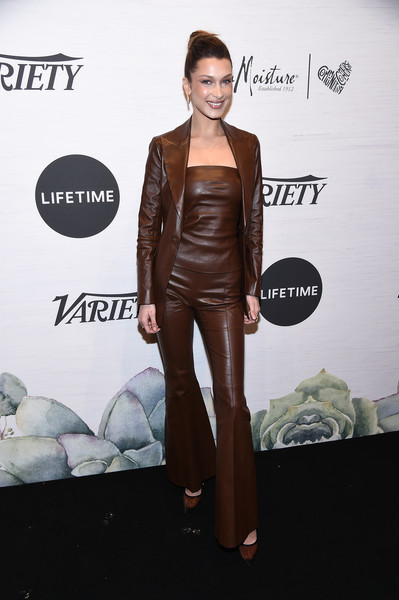 More Pics of Bella Hadid Classic Bun (1 of 16) - Updos Lookbook - StyleBistro [clothing,carpet,shoulder,fashion,dress,leather,fashion model,joint,suit,leg,power of women: new york,variety,new york city,cipriani midtown,bella hadid]