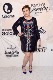 Strappy blue pumps added an edgy-sexy touch to Lena Dunham's look.