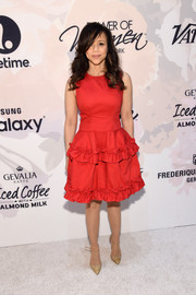 Rosie Perez paired her girly frock with embellished nude T-strap pumps.