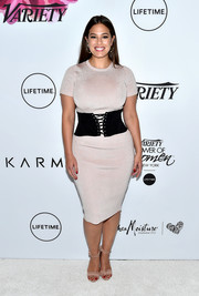 Ashley Graham complemented her dress with nude ruffle sandals by Schutz.