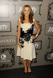 Felicity Huffman chose this nude dress with a full skirt and black floral designs across the bodice for her Victorian-inspired look at 'Variety's Power of Women' event.