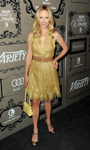 Anne was truly golden in this lace halter dress at the Power of Women event.