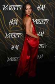 Cara Santana got majorly sultry in red Yousef Akbar silk pants and a matching backless top at the Variety Power of Young Hollywood event.