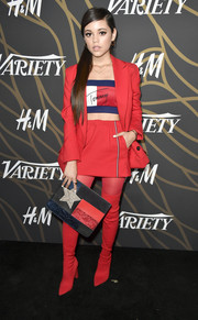 Jenna Ortega coordinated her outfit with red thigh-high boots and matching tights.