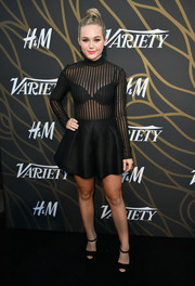 Brec Bassinger went for subtle sexiness in a fit-and-flare LBD with a sheer bodice at the Variety Power of Young Hollywood event.