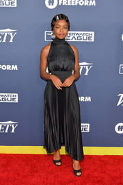 Marsai Martin complemented her frock with black peep-toe heels by Giuseppe Zanotti.