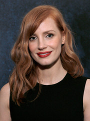 Jessica Chastain swiped on some red lipstick for a dash of color to her black outfit.