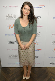 Eve Hewson looked sweet at the Variety Studio in her teal scoopneck sweater and print skirt, both by Louis Vuitton.