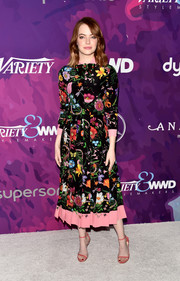 Emma Stone kept it chic and girly all the way down to her pink Jimmy Choo sandals.