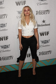 Dove Cameron teamed her top with bowed black capris.