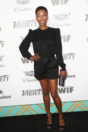 Samira Wiley teamed her outfit with a metallic tube clutch by Jimmy Choo.