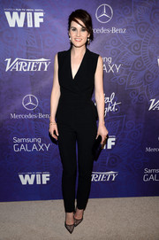 Michelle Dockery kept the edgy-elegant vibe going with a pair of black mesh pumps by Christian Louboutin.