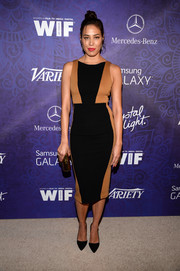 Michaela Conlin was modern and stylish in a sleeveless two-tone sheath dress at the Variety and Women in Film Emmy nominee celebration.