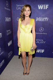 Sophia Bush topped off her ensemble with a chic pearlized hard-case clutch.