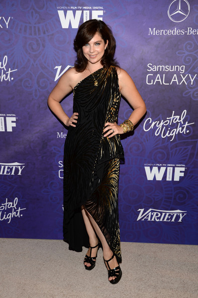 Daisy O'Dell finished off her ensemble with a pair of black YSL Tribute sandals.