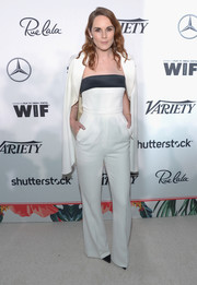 Michelle Dockery amped up the chic factor with a white cape jacket, also by Elie Saab.