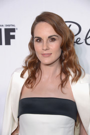 Michelle Dockery showed off a gorgeous wavy hairstyle at the Variety and Women in Film pre-Emmy celebration.