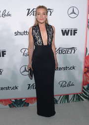 Piper Perablo cut a sophisticated figure in a black column dress with a lacy bodice and a down-to-there neckline during the Variety and Women in Film pre-Emmy celebration.