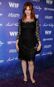 Christina looked classic in this black lace dress at the pre-Emmy event.