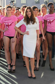 Lisa Snowden looked white hot in this sheath dress while shooting a Veet commercial in London.