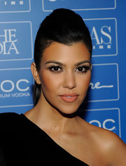 Kourtney looked radiant on the red carpet. The reality star completed her sleek pompadour and wispy lashes with glossy nude lipstick.