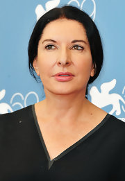 Marina Abramovic kept it simple and understated with a loose ponytail.