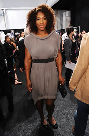 Serena Williams attended the the Vera Wang 2012 spring fashion show wearing a soft gray jersey dress with a rolled hem and neckline.