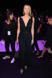 Maria Sharapova was svelte and statuesque in a plunging black jumpsuit by Vera Wang while attending the label's fashion show.