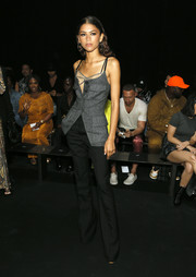 Zendaya Coleman layered a fitted gray top over a sheer cami for the Vera Wang fashion show.