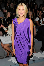 Stephanie looked ready for the red carpet in a draped purple dress. She paired her look with loose curls.