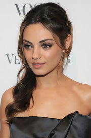 Actress Mila Kunis made a boho-chic appearance with her braided side ponytail.