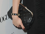 Amber Valletta paired her lace-up heels with a very elegant looking Chanel clutch. Quilted leather bags are certainly the most popular handbags among celebs.