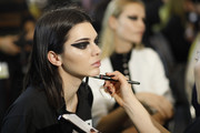 Kendall Jenner worked an extra-bold cat eye at the Versace runway show.