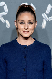 Olivia Palermo pulled her locks back into a sleek ponytail for the Versace Pre-Fall 2019 show.