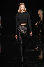 A black leather mini skirt completed Stella Maxwell's edgy ensemble.