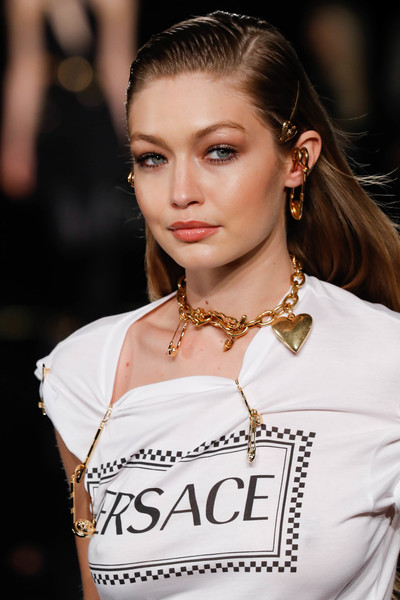 Gigi Hadid wore a cute gold charm necklace at the Versace Fall 2019 show.
