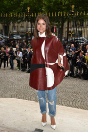 Miroslava Duma was a mix of mod and edgy in this tricolor leather cape coat during the Versace Haute Couture fashion show.