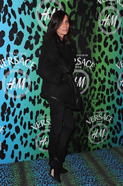 Emmanuelle Alt bundled up in a thick wool coat at the Versace for H&M cocktail event.