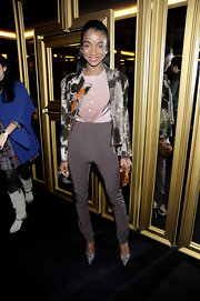Genevieve Jones sparkled in silver crystal-covered pumps at the Versace for H&M fashion event.