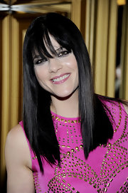 Selma Blair wore her dark shiny tresses super sleek and straight at the Versace for H&M fashion event.