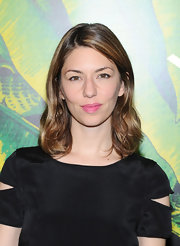 Sofia Coppola wore a bubblegum pink pop of color on her lips at the Versace for H&M fashion event.