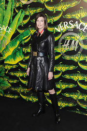 Linda Evangelista was darkly chic in a black leather jacket paired with black knee-high boots.