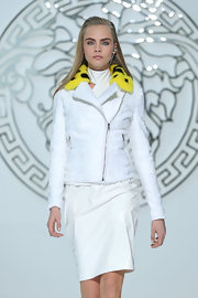 Cara Delevingne walked down the Versace runway wearing a zip-up jacket from their Fall/Winter 2013 collection.