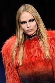 Natasha Poly wore a simple center-parted hairstyle while walking the Versace runway.
