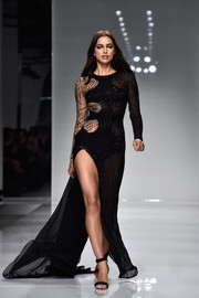Irina Shayk looked va-va-voom in a spiderweb-cutout gown with a hip-grazing slit while walking the Versace Haute Couture runway.