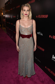 Emma Roberts got dolled up in a sequin-striped gown with a red velvet waistband for the premiere of 'In a Relationship.'