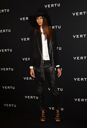 Chanel Iman unleashed her inner rocker with a pair of black leather pants with studded knees.